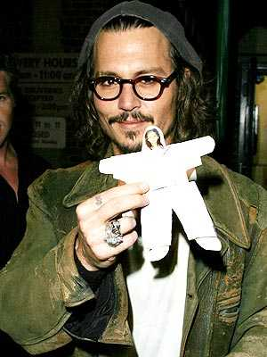 Johnny Depp is happily flashing a
